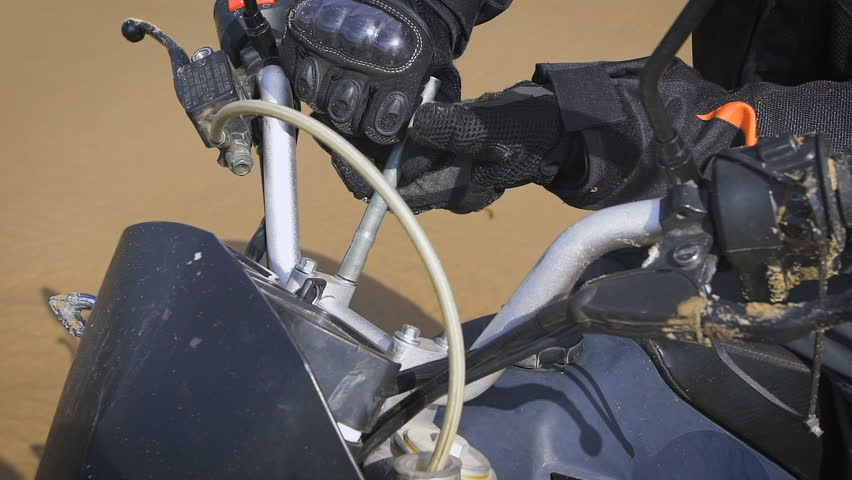 Hands in motorcycle gloves with a key bolt. | Shutterstock HD Video #17615242