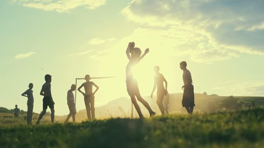 Unidentified children play football in a village on the background of sunset. Slow motion. | Shutterstock Video #17646247