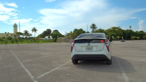 MIAMI - JUNE 27: Video of the all new redesigned 2016 Toyota Prius Eco, which is Americas best selling hybrid vehicle, in an empty parking lot June 27, 2016 in Miami FL, USA