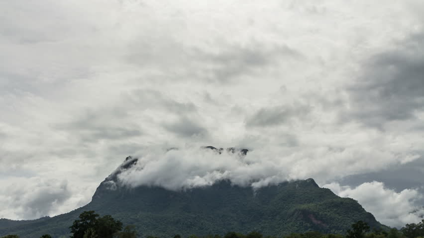 Storm clouds cover the mountain - HD stock footage clip