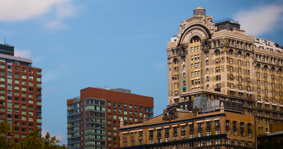 Manhattan, New York City, New York, USA - Battery Place Buildings with Whitehall Building in Lower Manhattan - Timelapse with zoom out