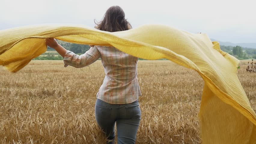 Beautiful girl young attractive woman wheat field happy portrait scarf flying in the wind smile  slow motion happy emotion healthy and natural background slowmo