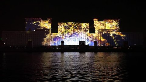 "MOSCOW, RUSSIA - OCTOBER 02, 2015: International Festival ""Circle of Light"". Laser video mapping show on facade of the Ministry of Defense in Moscow, Russia. 3D projection mapping on building"