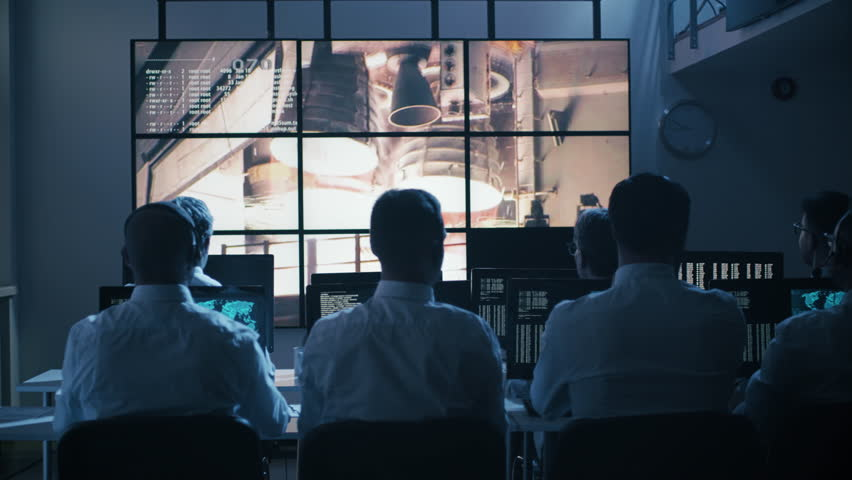 Group of People in Mission Control Center filled with Displays, Celebrating Successful Rocket Launch. Elements of this image furnished by NASA. Shot on RED Cinema Camera in 4K. | Shutterstock HD Video #17724682