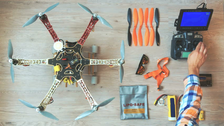 Custom drone (hexacopter) testing and run on the wooden floor | Shutterstock HD Video #17732641