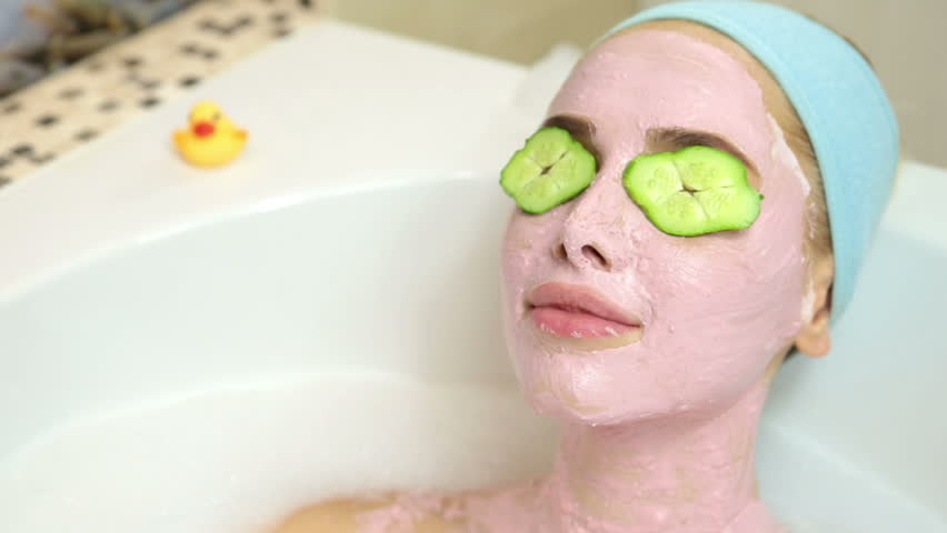 A woman takes a bath with cosmetic mask on her face. Cosmetic procedures and Recreation | Shutterstock HD Video #17738452