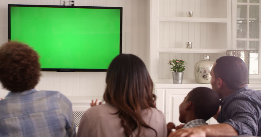 Four People Family Watching Tv With Green Screen Siting