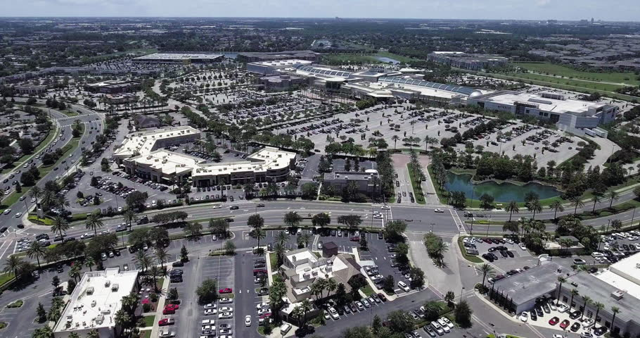 The Mall At Millenia Highway With Trees, Houses and Ponds In Shot