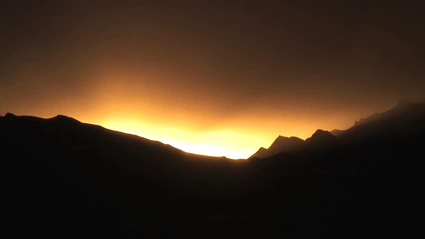 Sunset Over Mountains on Tibetan Plateau
