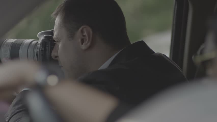 4K Spy, paparazzi or detective in the car, shooting on camera. Shot on RED EPIC Cinema Camera