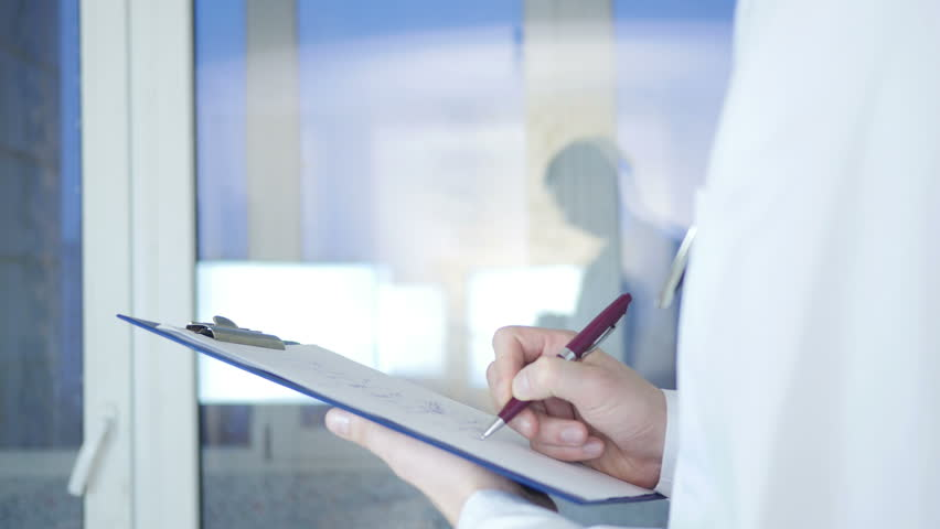 Medical Record In Hospital Doctor Writing Prescription in Hospital | Shutterstock HD Video #17829166
