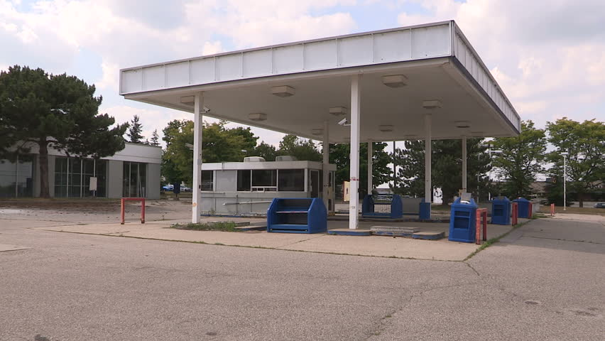 Waterloo, Ontario, Canada July 2016 Old abandoned independent gas station after bankruptcy in recession.