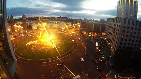 Aerial View of traffic on Placa Espanya and Montjuic Hill with National Art Museum of Catalonia, Barcelona, Spain