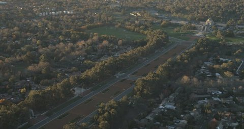 A late afternoon aerial shot of ANZAC Parade up to the Australian War Memorial in Canberra as the sun is going down. Shot on a Red Epic.