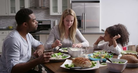 Girl and her mixed race parents dining in their kitchen, shot on R3D