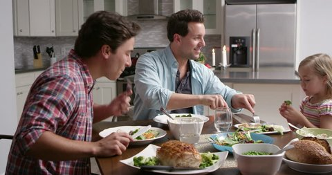 Male gay couple and daughter dining in their kitchen, shot on R3D
