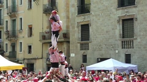 BARCELONA, SPAIN - JUNE 26, 2016: Castellers group of people that build human castles on June 26, 2016 in Barcelona.  Castles is a Human Tower traditional festivities in Catalonia Spain.