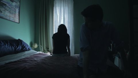 Tension between couple in the bedroom (darker)