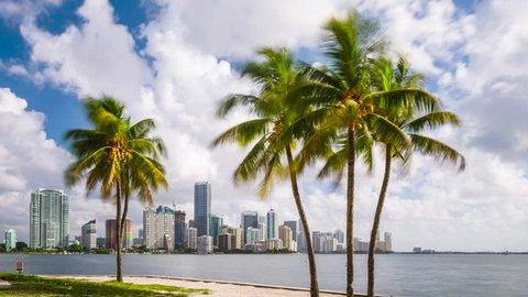Miami, Florida, USA downtown city skyline time lapse over Biscayne Bay.
