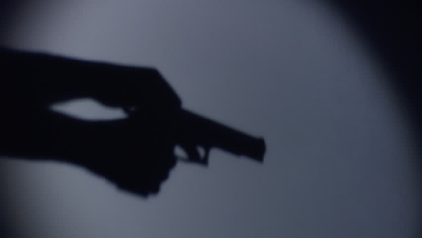 silhouette of a guy loading a gun