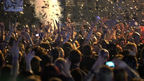 HELSINKI, FINLAND - JUNE 01, 2016: A lot of fans applauding and waving their hands at a rock concert. Heavy Metal Rock Festival Tuska