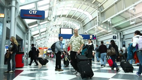 CHICAGO - FEB 2: (Timelapse View) People moving in the Chicago O'Hare Airport Febuary 2, 2011 in Chicago, IL. O'Hare is now the third busiest airport in the world with 66,665,390 passengers passing through the airport in 2010, a +3.3% change from 2009.