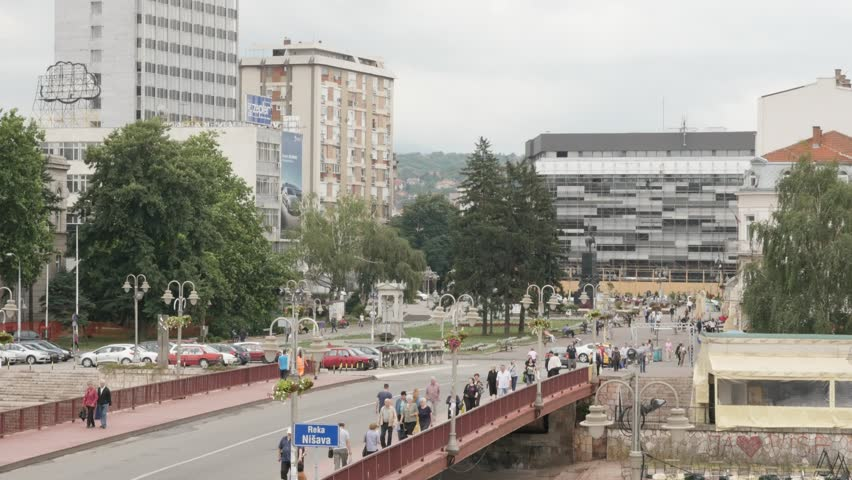 NIS, SERBIA - JUNE 2016: City center and traffic crowd of Nis in eastern Serbian capital by the day with river Nisava bridge