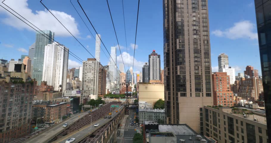 NEW YORK - Circa July, 2016 - A passenger's forward perspective riding the Roosevelt Tramway to Manhattan.   | Shutterstock HD Video #18058222