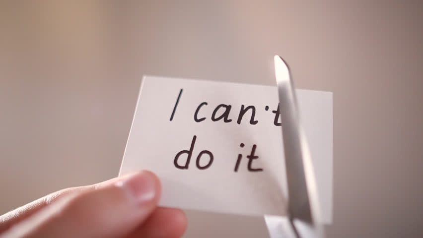 Man using scissors to remove the word can't to read I can do it concept for self belief, positive attitude and motivation   Shutterstock HD Video #18083563
