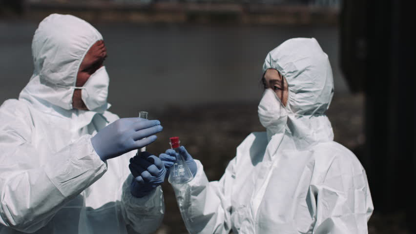 Forensic scientist examining sample at river bank | Shutterstock HD Video #18089041