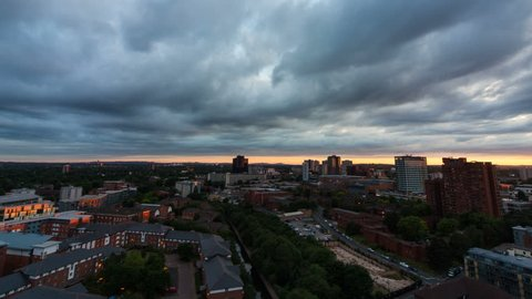 Birmingham sunset time lapse looking towards the University. Filmed from the top floor of the iconic Cube building.