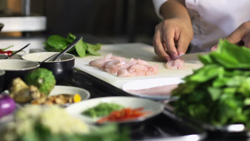 Close-up of chef hands cooking and preparing Asian food and sushi in restaurant kitchen. Rack focus | Shutterstock Video #1811054