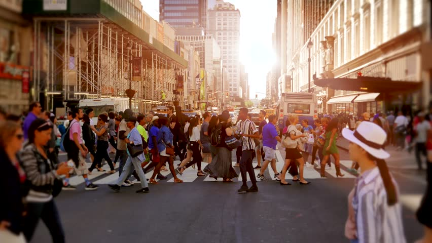NEW YORK - CIRCA: MAY 2016, crowd of people crossing street in the city commuting to workplace. pedestrians walking in business district #18145912