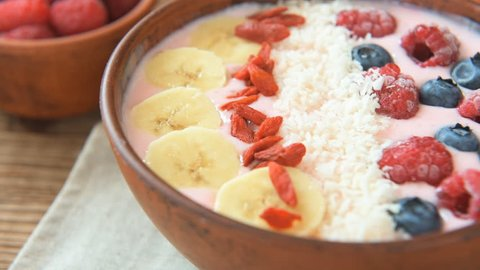 Smoothie breakfast bowl topped with goji and berries