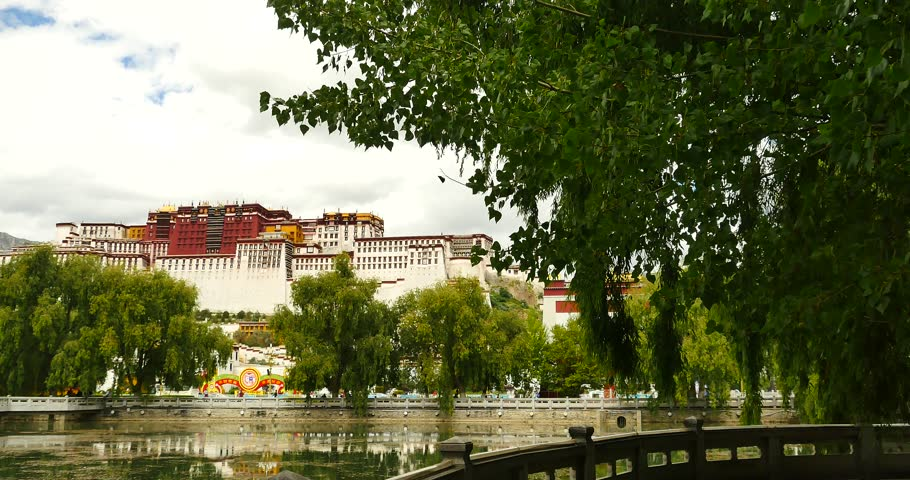 4k Potala reflection on lake in Lhasa park,Tibet.lake with willow. gh2_09765_4k