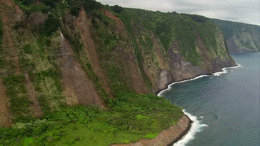 Aerial slow fly by of Hamakua Coast Waterfalls and coastline, Hawaii