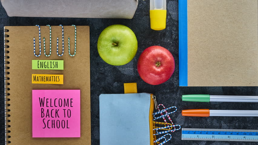 """Recycled Paper Notebook and School Supplies with text: """"welcome back to school"""", """"English, Mathematics, History"""" and empty space in the end for writing, Back to School Theme Stop Motion."""