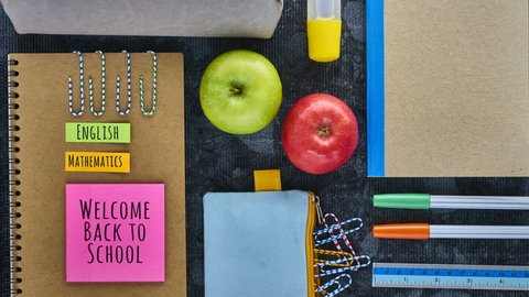 "Recycled Paper Notebook and School Supplies with text: ""welcome back to school"", ""English, Mathematics, History"" and empty space in the end for writing, Back to School Theme Stop Motion."