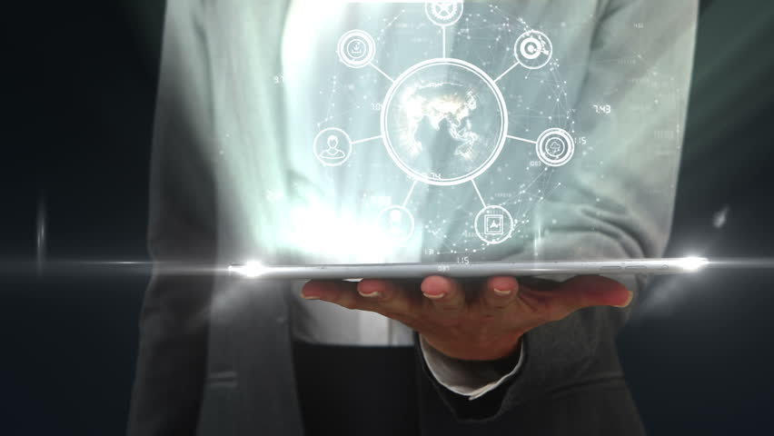 Mid section of businessman using digital tablet against black background