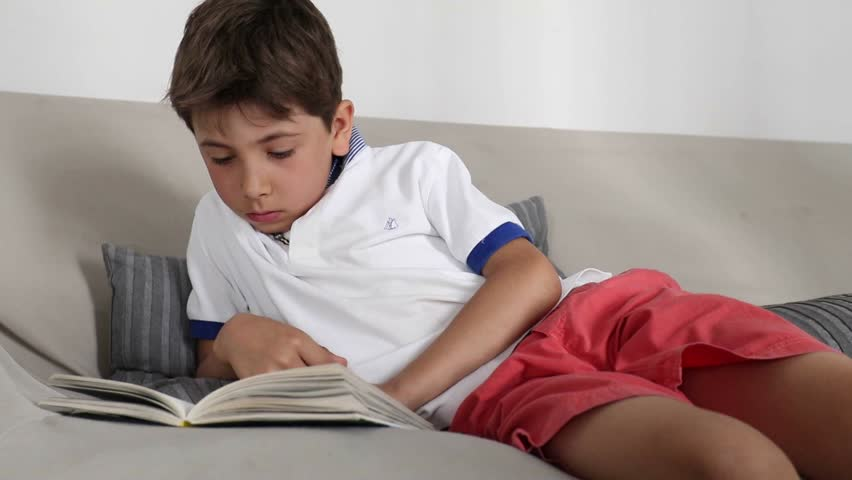 Young Boy Reads Book. Professional Model Shot In May, 2011 ...