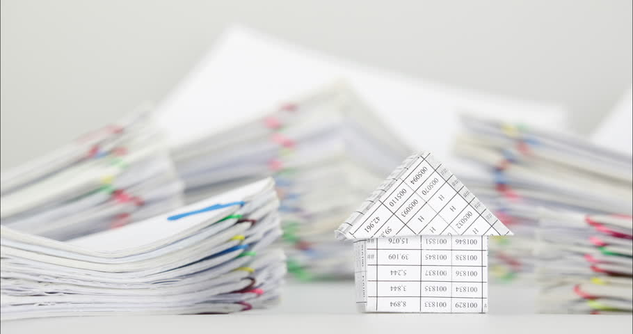 House have blur pile overload paperwork of receipt and report with colorful paperclip place on white background time lapse. Pile of document is increasing as work successful. Business concept footage. | Shutterstock HD Video #18355132
