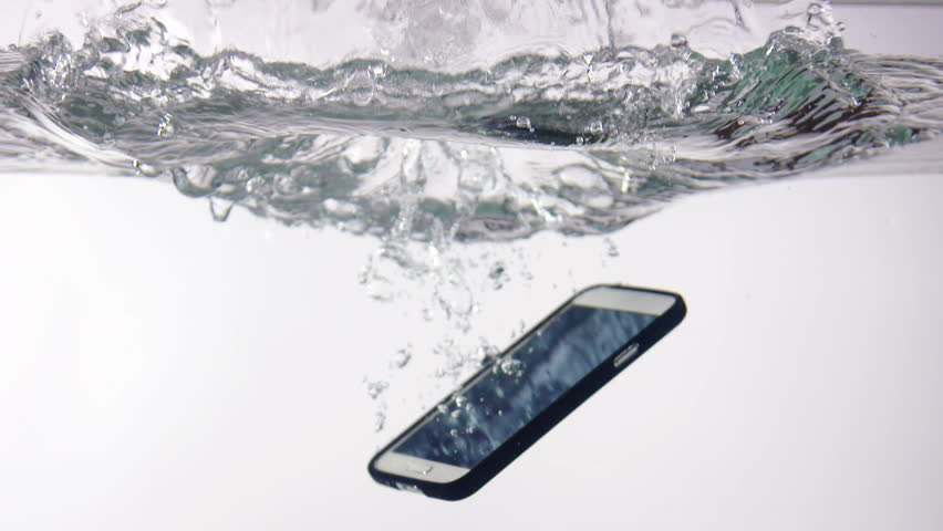 Smart phone with incoming call on display falling in water with splash on white background slow motion closeup