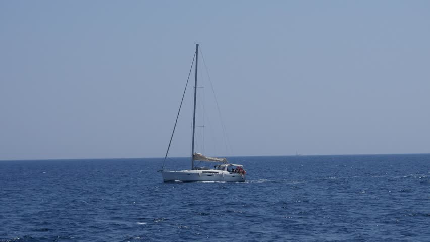 Boat / Yacht sails in the background of open sea with blue clear skies in Malta, Sailboat  | Shutterstock HD Video #18368722