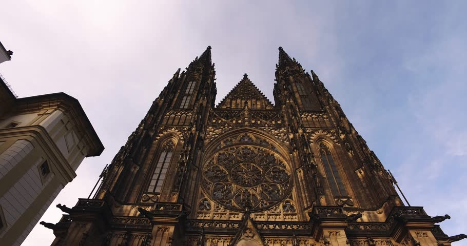 Camera reveals old gothical cathedral of Saint Vitus in Prague castle during sunset historical medieval architecture in European old town