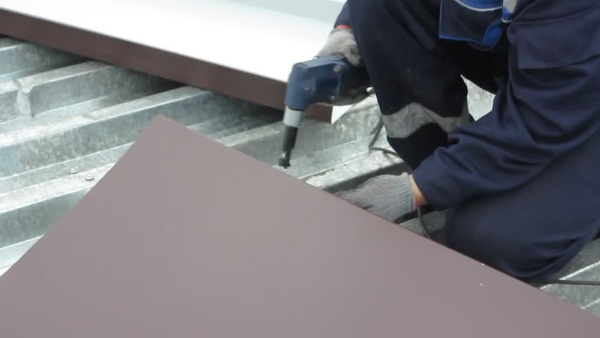 Roofers repair a metal roof  | Shutterstock HD Video #18375712