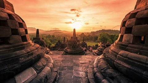 Buddist temple Borobudur at amazing sunset in Indonesia. 4K Timelapse - Java, Indonesia, June 2016.