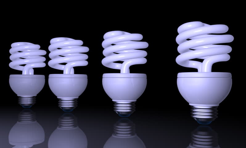footage of a spiral shape CFL light in black background