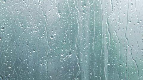 heavy rain on window glass background focus on right side