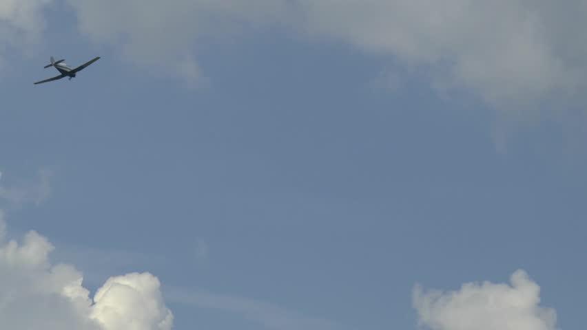 Airplane Flies Through White Clouds in Blue Sky   Shutterstock HD Video #18412672