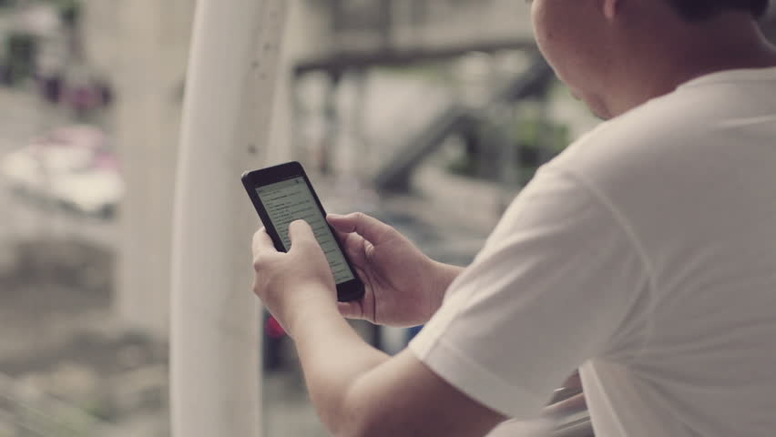 Man using smartphone in the city | Shutterstock HD Video #18439072